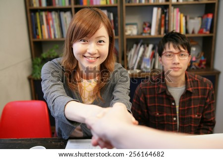 Portrait of a businessman and a businesswoman shaking hands