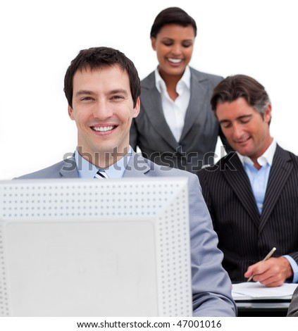 Portrait of a businessman and his team working at a computer in the office - stock photo