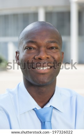 Portrait of a businessman from Africa in front of his office   - stock photo