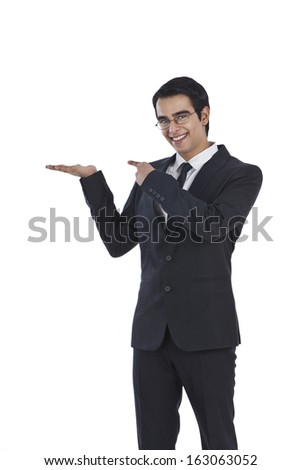 Portrait of a businessman gesturing - stock photo