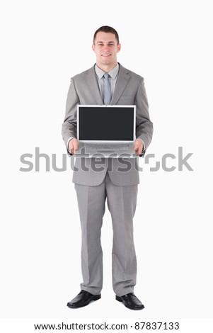 Portrait of a businessman holding a laptop against a white background - stock photo