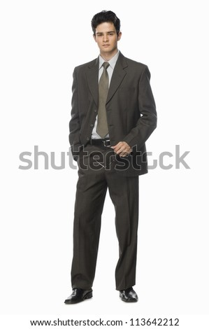 Portrait of a businessman holding his eyeglasses