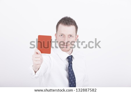 Portrait of a businessman holding up a red card as a symbol for negative expression. Studio shot on a white Background. - stock photo