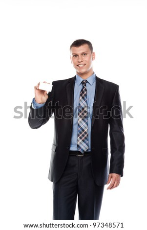 Portrait of a businessman in a business suit with a white business card in his hand
