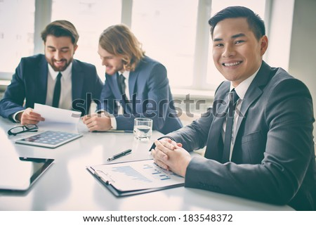 Portrait of a businessman in board room looking at camera  - stock photo