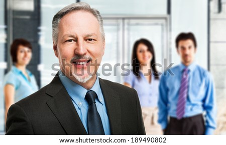 Portrait of a businessman in front of a group of people