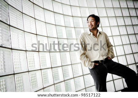 Portrait of a businessman looking at the window