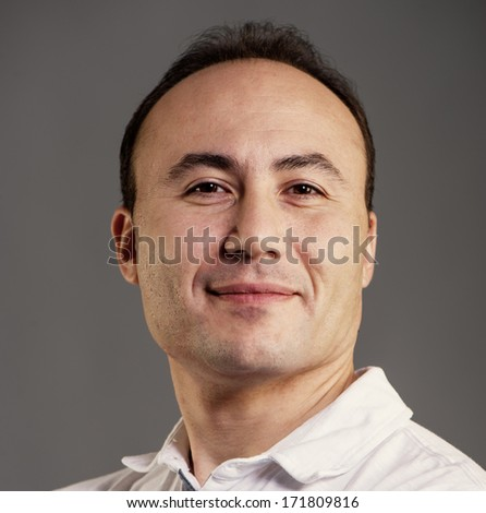Portrait of a businessman on a dark background, close-up, age 35-40 years,