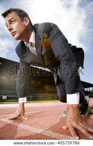 Portrait of a businessman on the starting blocks - stock photo