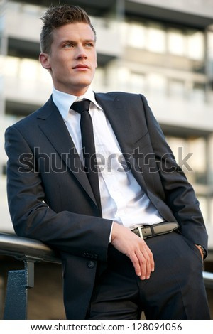 Portrait of a businessman outside the office - stock photo