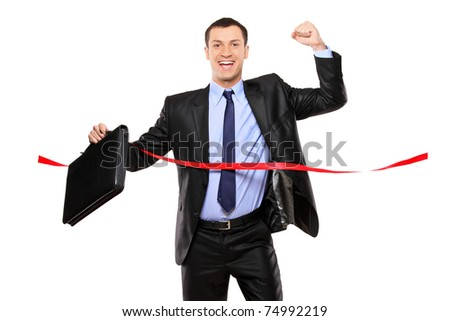 Portrait of a businessman running at the finish line isolated on white background