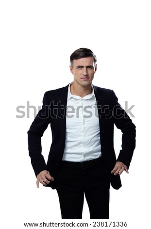 Portrait of a businessman showing his empty pockets - stock photo