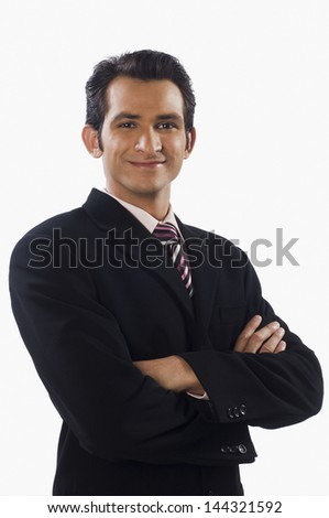 Portrait of a businessman standing with his arms crossed and smiling