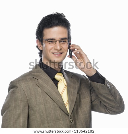 Portrait of a businessman talking on a mobile phone - stock photo