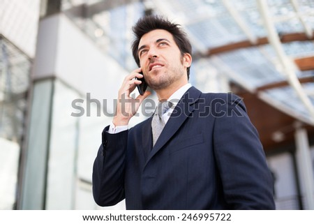 Portrait of a businessman talking on the phone - stock photo
