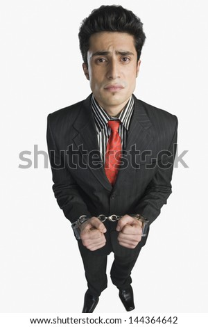 Portrait of a businessman tied up with handcuffs - stock photo