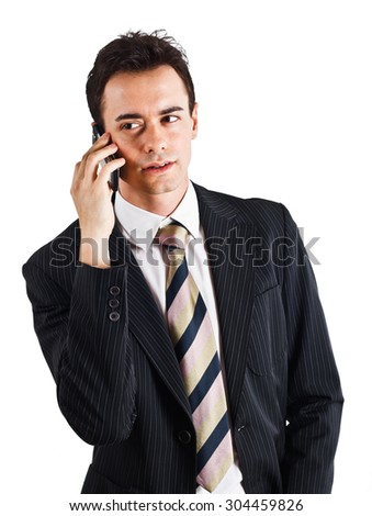 Portrait of a businessman using a cell phone - stock photo