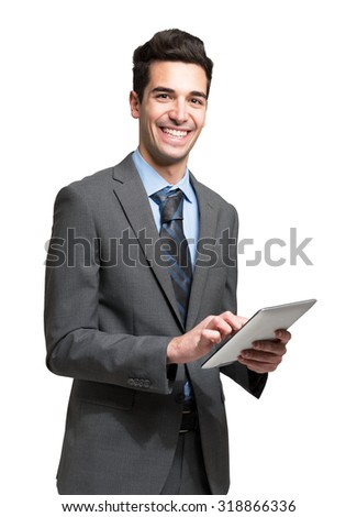 Portrait of a businessman using a digital tablet. Isolated on white - stock photo