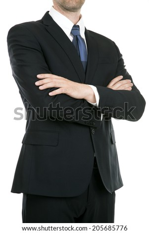 Portrait of a businessman wearing a suit smiling with his arms folded - stock photo