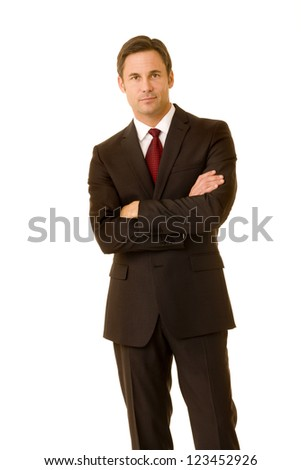 Portrait of a businessman wearing suit with his arms folded - stock photo