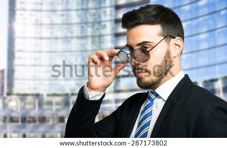 Portrait of a businessman wearing sunglasses - stock photo