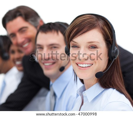 Portrait of a businesswoman and her team working in a call center in a company - stock photo