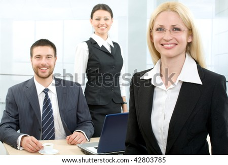 Portrait of a businesswoman and people on the background