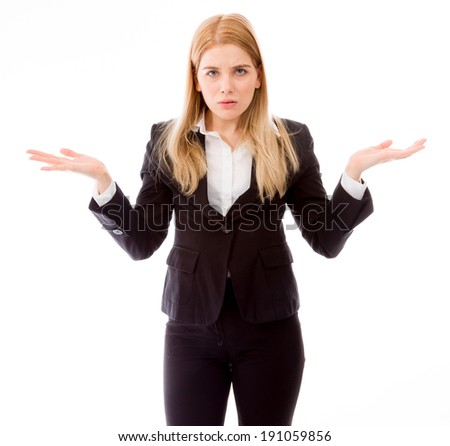 Portrait of a businesswoman arms out asking what's the problem - stock photo
