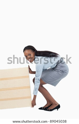 Portrait of a businesswoman dragging a panel against a white background