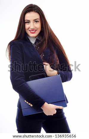 Portrait of a businesswoman holding a blue briefcase isolated on white background