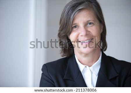 portrait of a businesswoman in a suit - stock photo
