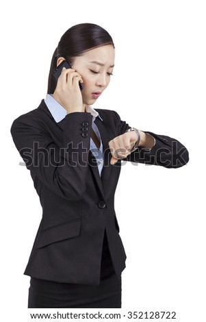 Portrait of a businesswoman looking at her watch - stock photo