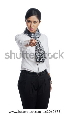 Portrait of a businesswoman pointing