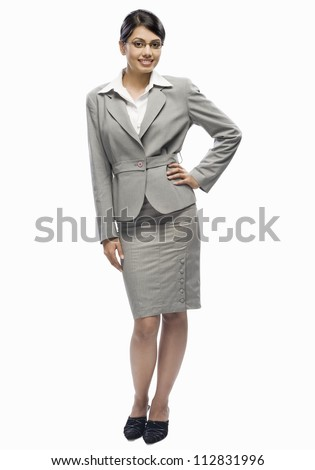 Portrait of a businesswoman standing against a white background - stock photo