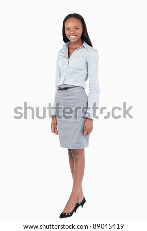 Portrait of a businesswoman standing up against a white background - stock photo