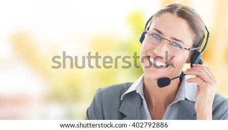 Portrait of a call center executive wearing headset against ladder used as shelf in office - stock photo