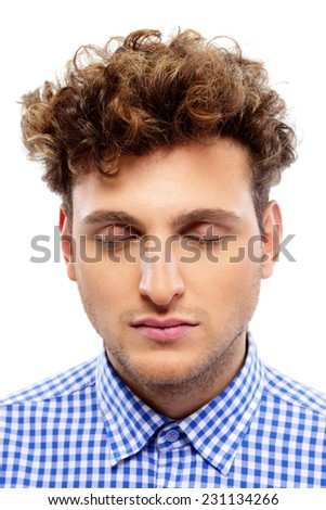 Portrait of a casual man with closed eyes on white background - stock photo