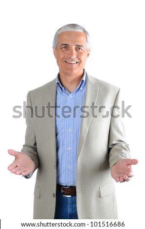 Portrait of a casual middle aged man wearing blue jeans, dress shirt and a sport coat. Man has both hands extended in front of himself over a white background. - stock photo