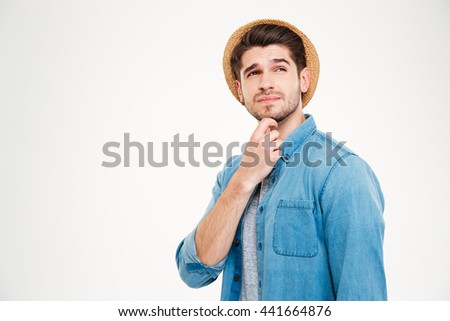 Portrait of a casual pensive man standing isolated on a white background - stock photo