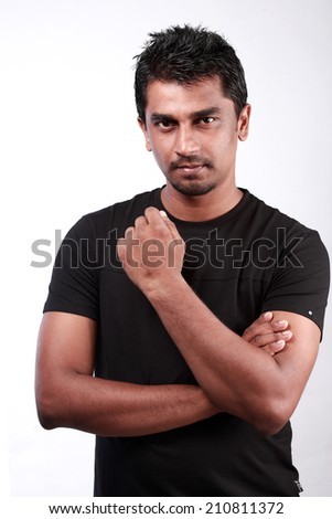 Portrait of a casually dressed  Indian young man  - stock photo