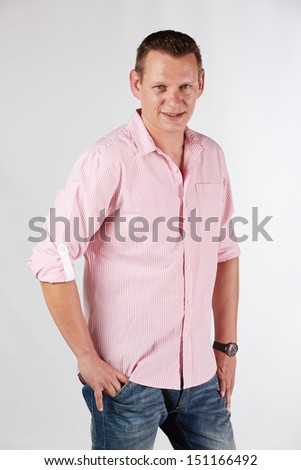 Portrait of a casually dressed young adult caucasian man against a neutral background.