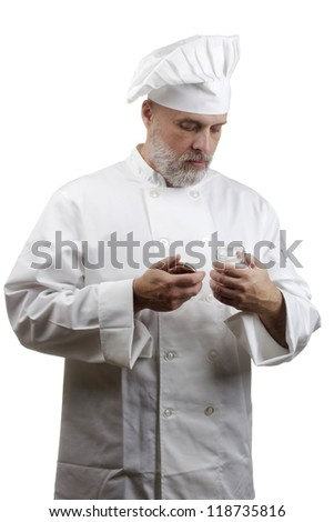 Portrait of a caucasian chef in his uniform on a white background. - stock photo