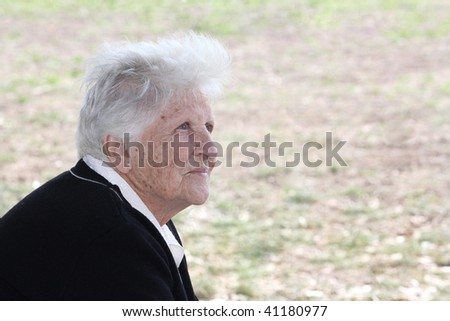 portrait of a caucasian elderly woman - stock photo