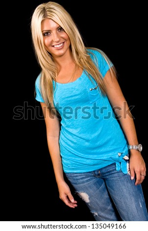 Portrait of a Caucasian female on black background - stock photo