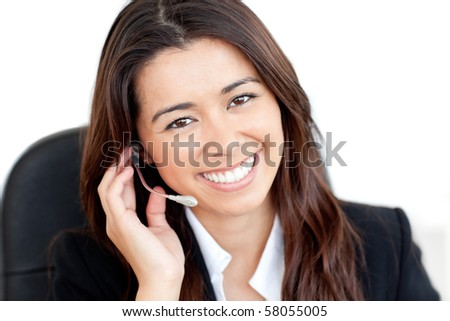 Portrait of a charismatic asian businesswoman with headphones smiling at the camera - stock photo