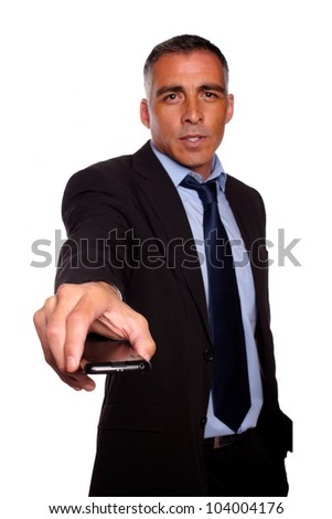 Portrait of a charismatic business man giving you a cellphone on black and blue suit against white background - stock photo
