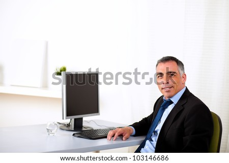 Portrait of a charismatic hispanic executive working at the office - stock photo