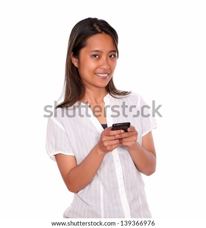 Portrait of a charming asiatic young woman calling on cellphone while is looking at you on isolated background
