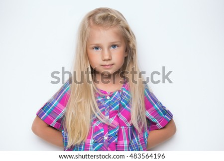 Portrait of a charming blonde little girl
