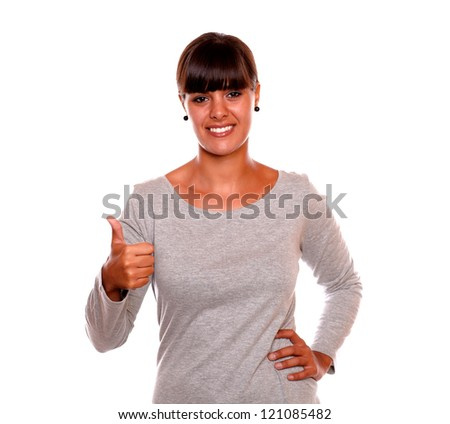 Portrait of a charming female smiling and showing you ok sign standing over white background - stock photo